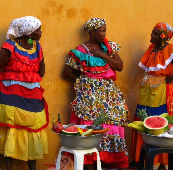 This image represents the African influence in Columbia . This is a group of Afro-Columbian women selling fruit in Cartagena.